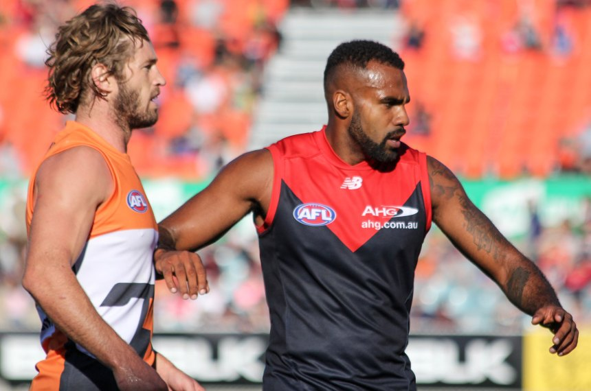 Melbourne's Harry Lumumba (right) & Giants co-captain Callan Ward