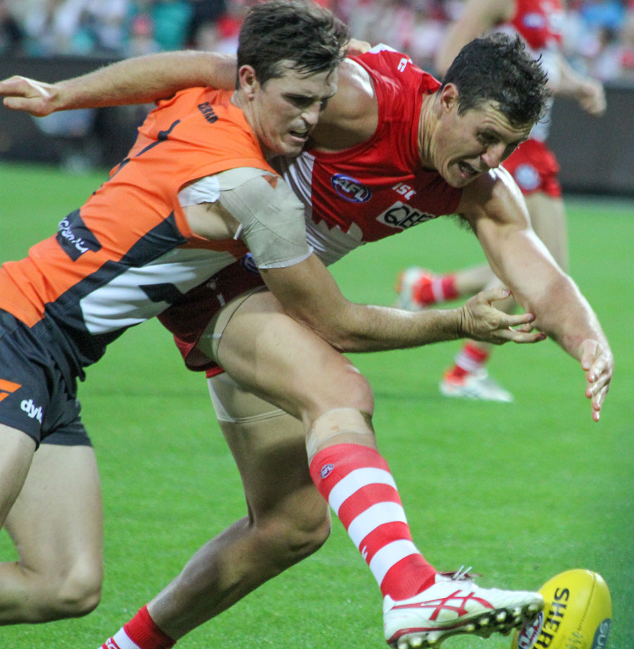 "Kurt Tippett, Sydney Swans (right) & Phil Davis This contest encapsulates the spirit of the ""Battle of the Bridge"" derby game"