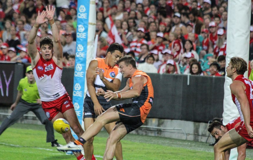 Rhys Palmer snaps an outstanding goal whilst under pressure from the Sydney Swans defence