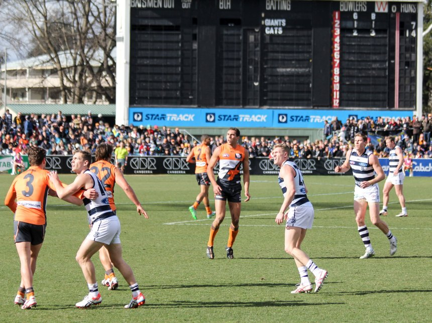 One of the many ruck duels during the GWS Giants v Geelong game played at Manuka Oval