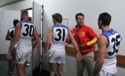 Gold Coast Suns assistant coach Dean Solomon greets his players. Photo: Jodie Newell