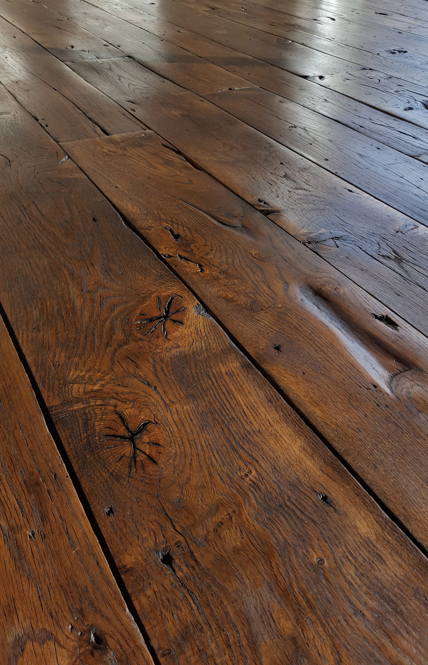 reclaimed 400 year old French oak floor from French army tank garrison