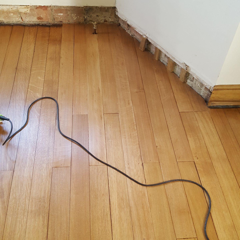 Stunning repair to Edwardian English oak floor after fire damage