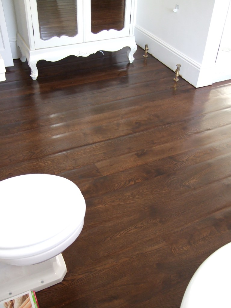 Hand sanded and rolled dark oak stained oak bathroom floor