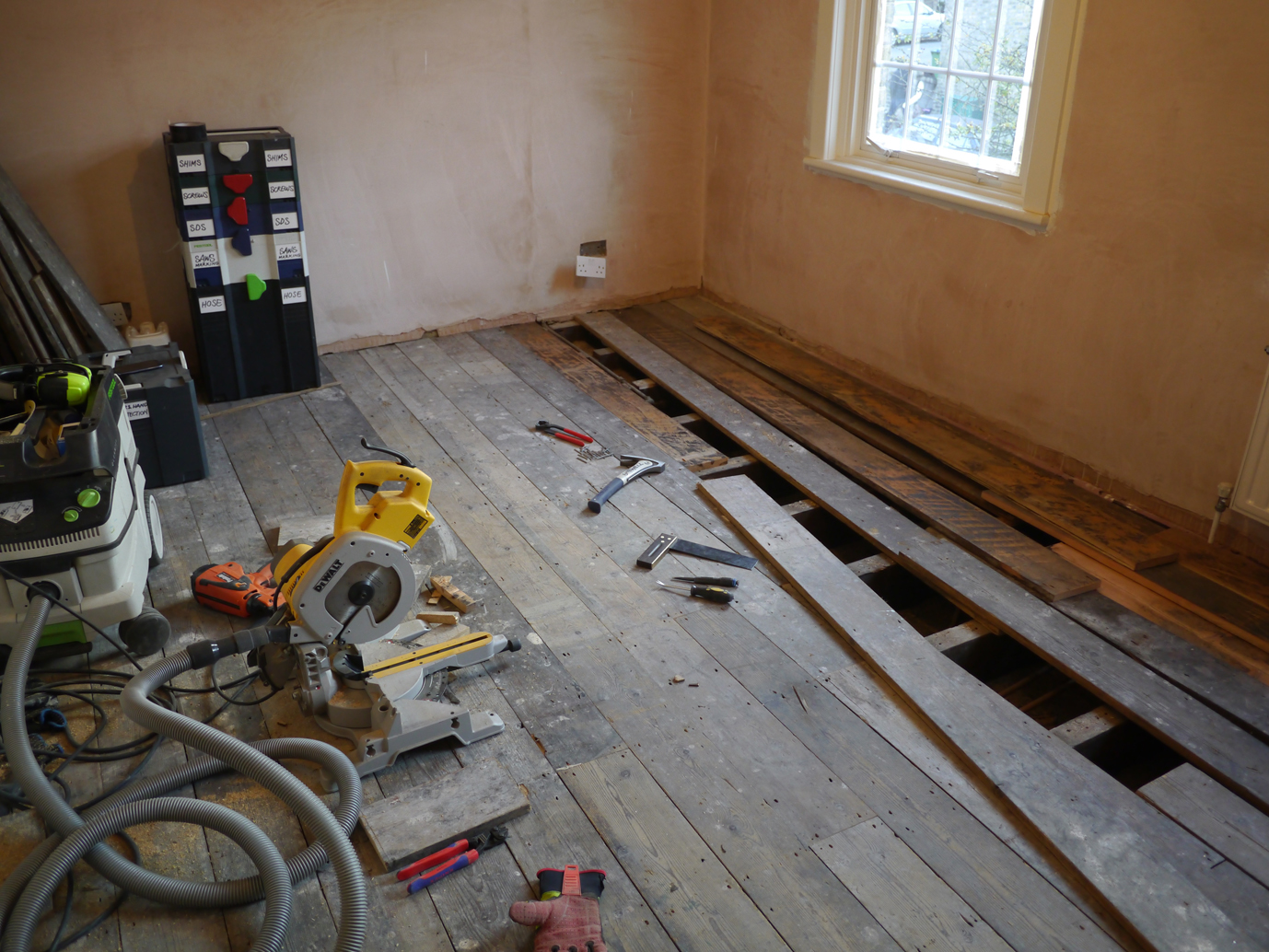 Old pine floor in need of replacement with reclaimed pine boards
