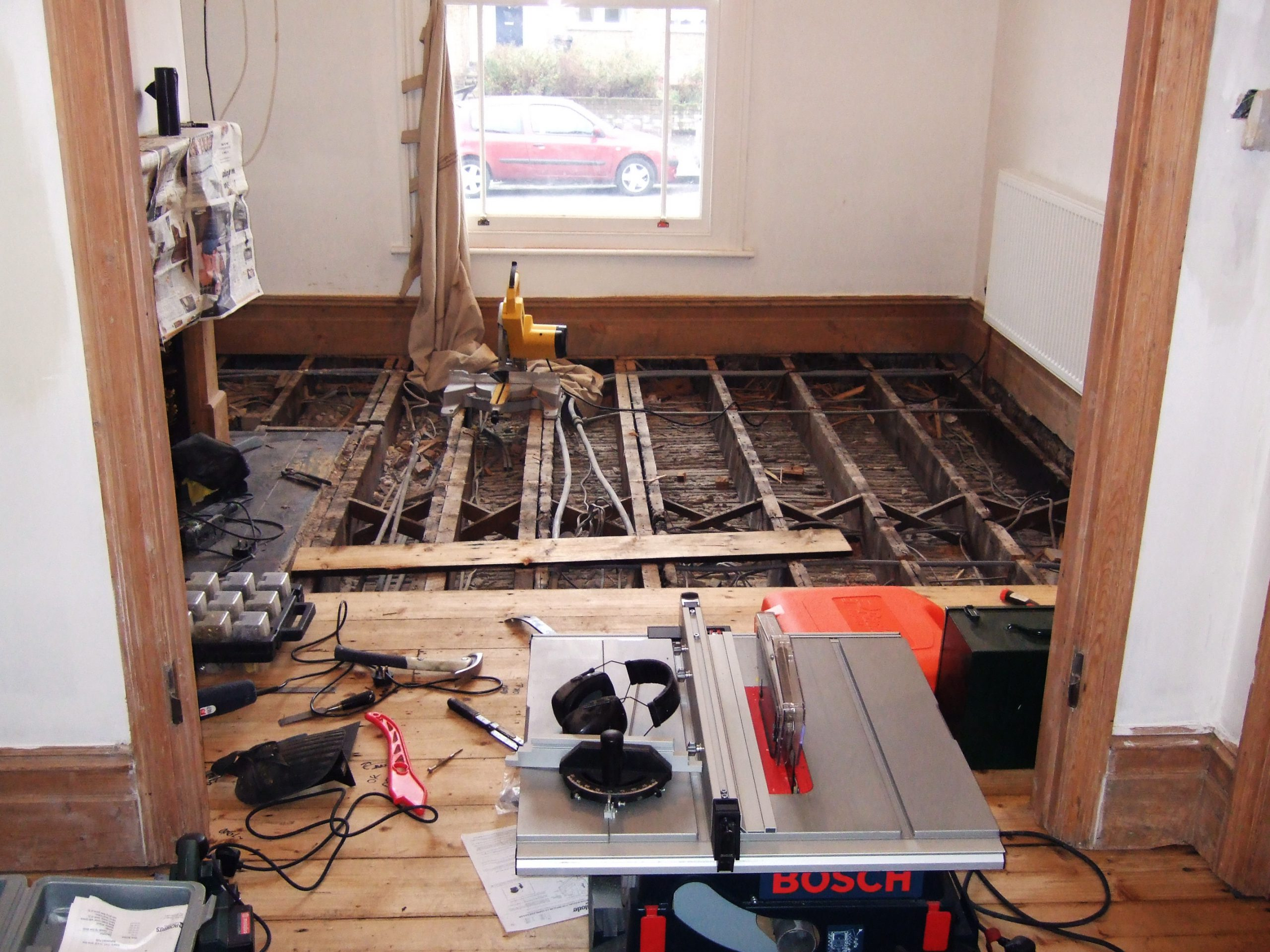 Old pine floor being expertly replaced with new reclaimed boards