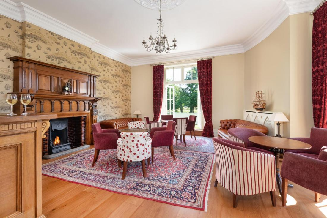 Camerton Hall lounge with sanded and finished floor and restored and French polished fire surround