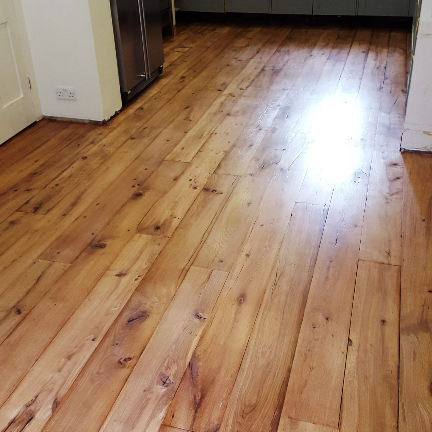 Reclaimed oak floor fitted and sanded
