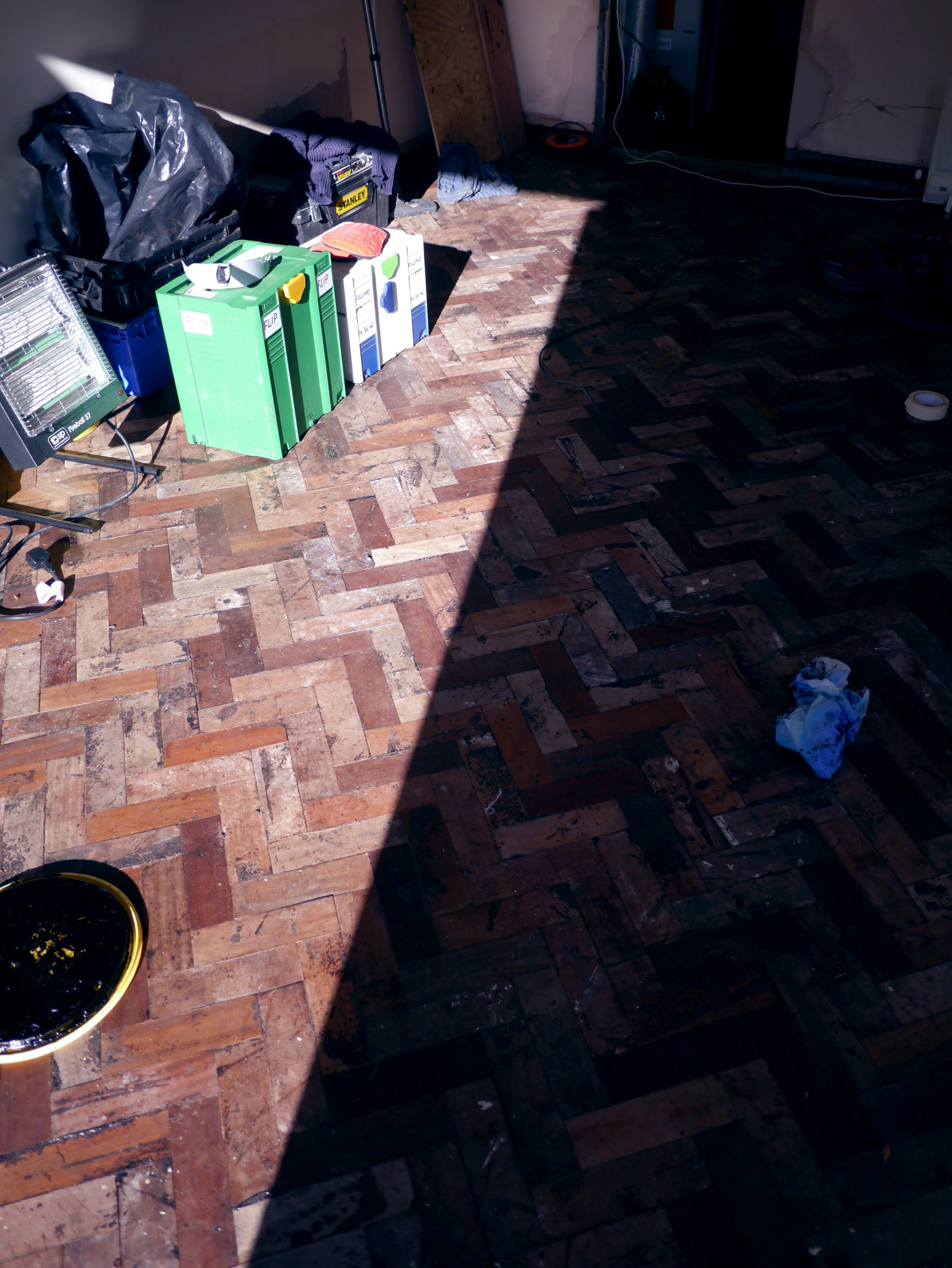 Reclaimed mahogany parquet floor fitted