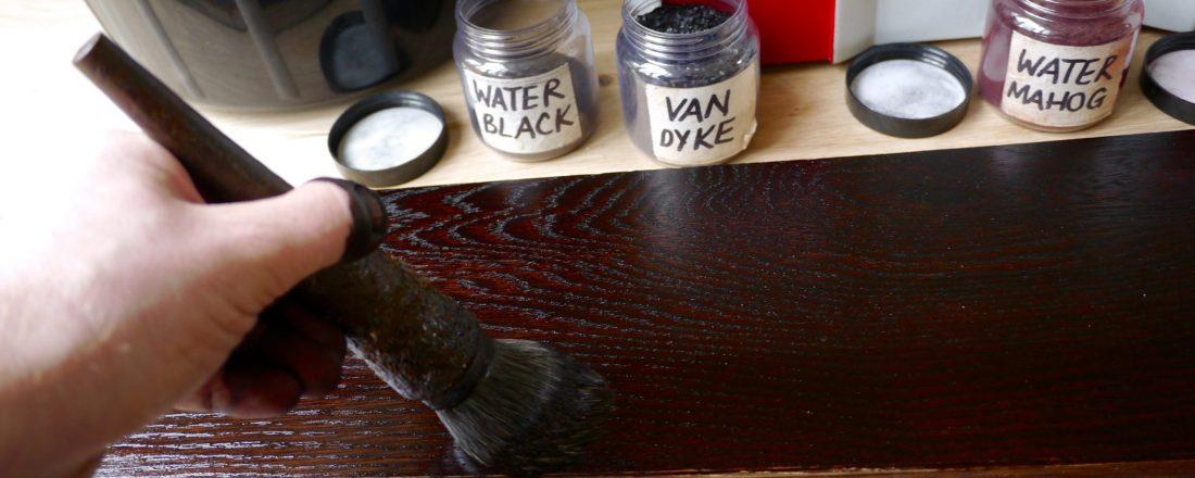 Applying shellac whilst preparing dark oak floor colour sample
