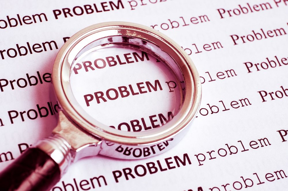 Magnifier is focused on word 'problem'. This image is meant to portray communication difficulties that can be addressed by a hold me tight workshop New England.