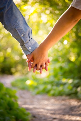 Hand holding showing better communication skills after attending emotionally focused couples therapy intensive in Massachusetts.