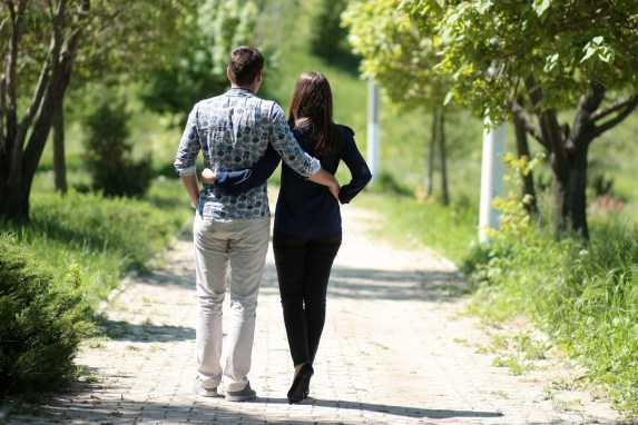 Middle aged Heterosexual couple walking down path together. This image represents a couple who has learned how to fix a relationship from a private marriage retreat. Couples arrive falling out of love and leave in a good relationship and a healthy relationship.