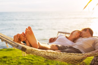 Couple relaxing in hammock. This image is meant to portray emotional connection after attending a Hold Me Tight Retreat in New England or a Hold Me Tight Retreat in Massachusetts.
