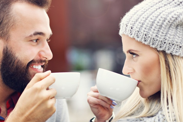 Couple drinking coffee and looking in each other's eyes. This image is meant to portray emotional connection and good communication that happens from attending a Hold Me Tight couples Workshop Maine.