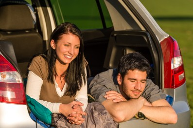 Couple relaxing in back of their car with trunk opened up. This signifies emotional connection after attending intensive marriage counseling in Massachusetts or marriage counseling retreats in New England.