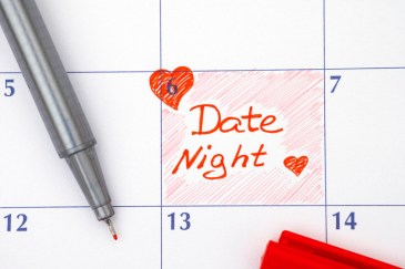 Calendar with the 6th highlighted with a heart and words 'Date Night' on it in red with red pen nearby. This signifies creating emotional connection and improving couples communication by intensive marriage counseling in Massachusetts.