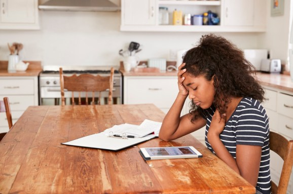 Teenage Girl At Home Using Digital Tablet.  Signifies helping teenagers during COVID and keeping communication between parents with emotionally focused couples therapy intensives in massachusetts.