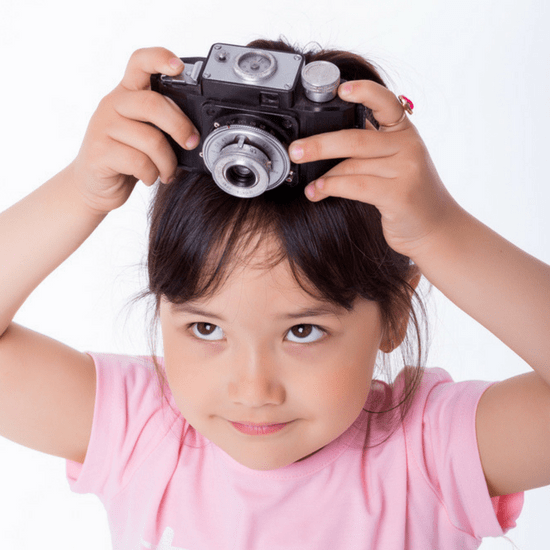 Allow your child to capture moments of your road trip via camera or video