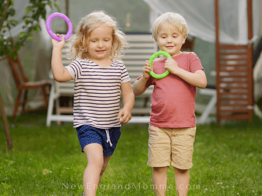 Two kids playing ring toss