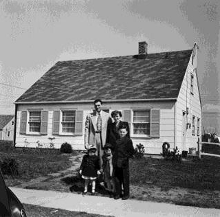 Figure 6. Period photograph of family outside their home in Levittown, New York (University of Illinois at Chicago University Library)
