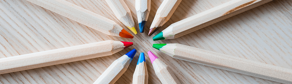 colored pencils with points together in a circular pattern