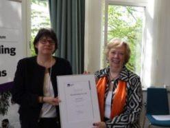 ILAC's Executive Director, Agneta Johansson presents award to Joan Winship