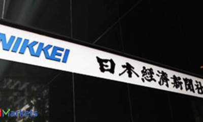 Nikkei ends lower, posts biggest monthly gain in near 27 yrs on vaccine cheer