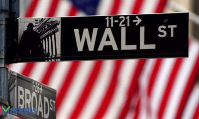 Dow Jones rebounds after Fed-induced pullback; financials and energy stocks gain