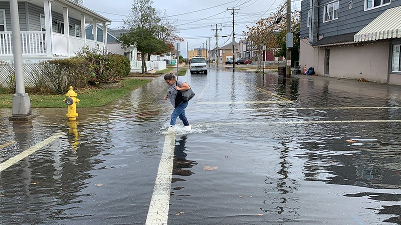 Supporters of the NJ Organizing Project trudged through flood waters Tuesday to show solidarity with homeowners who are still not back in their homes seven years after Superstorm Sandy.