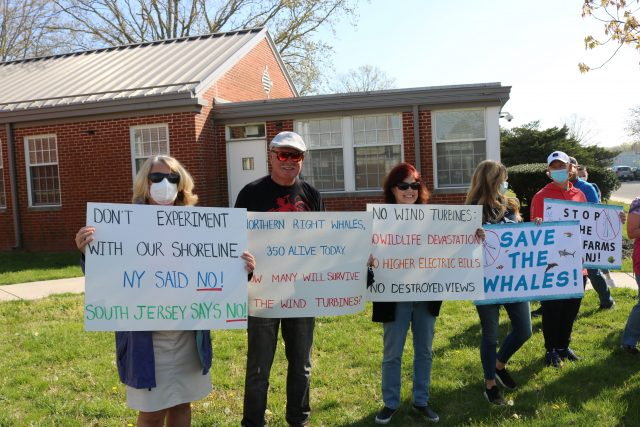 Peaceful protestors from Ocean City display signs opposing a project slated for the waters 15 miles off the South Jersey coast