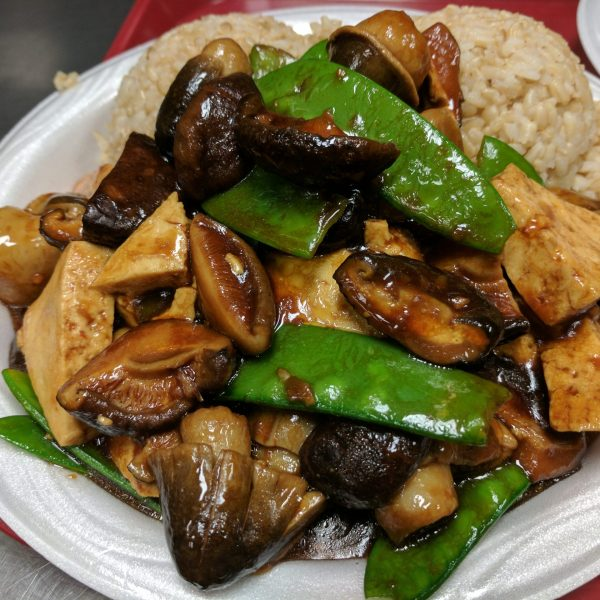 Snow peas with black and straw mushrooms