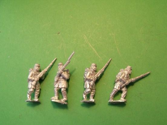 Infantry in Kepi, Frock Coat & Back Pack, Marching