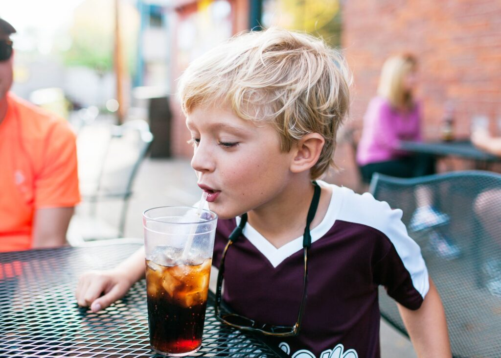 kid with soda