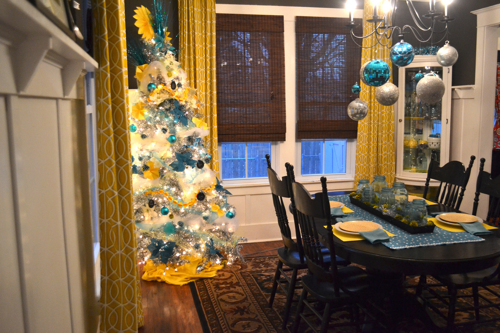A Silver Christmas Tree With Yellow And Turquoise DIY Ornaments NewlyWoodwards