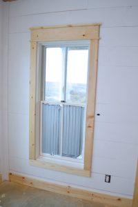 DIY shiplap walls and farmhouse trim - NewlyWoodwards