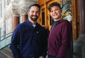 Image of CASA volunteer and young boy smiling outside of court