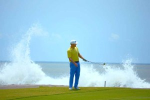 Estrella del Mar Golfer with ocean waves crashing