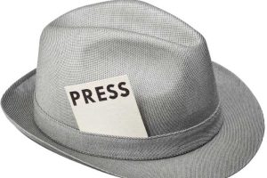 Golf writer intern might wear a hat with a press card in the hat band