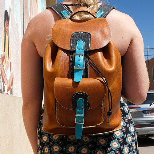 Orange leather backpack with turquoise accents