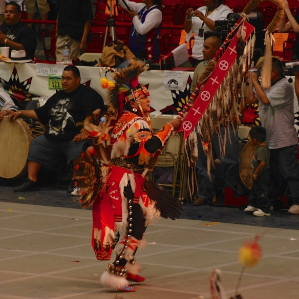 When the Eagle Staff enters the arena to begin the Grand Entry, everyone stands.
