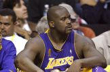 AUBURN HILLS, MI - JUNE 10: Shaquille O'Neal #34 of the Los Angeles Lakers looks on from the bench in the fourth quarter of game three of the 2004 NBA Finals against the Detroit Pistons on June 10, 2004 at The Palace of Auburn Hills in Auburn Hills, Michigan. NOTE TO USER: User expressly acknowledges and agrees that, by downloading and or using this photograph, User is consenting to the terms and conditions of the Getty Images License Agreement. (Photo by Tom Pidgeon/Getty Images)