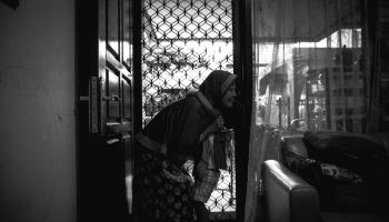 Lilik Sulistiowati, known as Mami Vera, at the shelter she founded in Dukuh Kupang Timur, Surabaya, Indonesia.