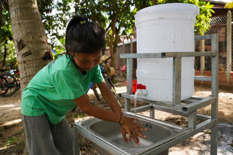 A donor gave a hand-washing station and volunteers taught students how to wash their hands properly at the Village Library in Areak Svay Village.