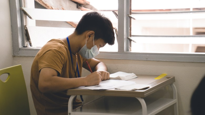 A student sits for exams at a refugee learning centre in Kuala Lumpur run by Kachin refugees from Myanmar in December 2020.