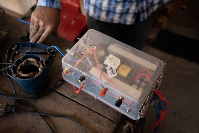 A homemade electric fishing kit that had been brought in to a hardware shop in Kratie's provincial capital by Vietnamese-Cambodian fishers for repair.