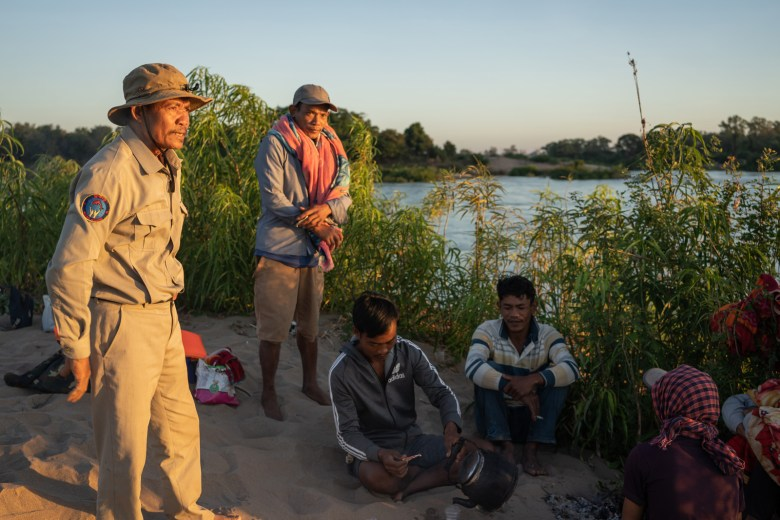 Village chief Sar Kim and community fishery patrollers discuss their patrol plans for the next 24 hours after spending a night camping on a sandbank in the Mekong while on patrol.