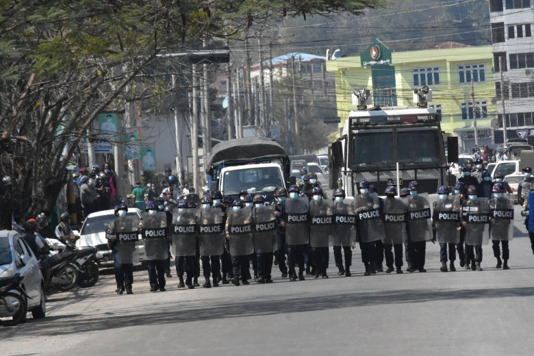 Myanmar security forces line up in formation during anti-coup protests in Taunggyi, Shan State on 10 March 2021.