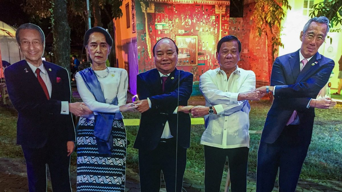 Cutout figures of Asean leaders with crossed arms shaking hands in a Bangkok park in 2018. Figures include, from left to right, Malaysia's Mahathir Mohamad, Myanmar's Aung San Suu Kyi, Vietnam's Nguyen Xuan Phuc, the Philippines' Rodrigo Duterte and Singapore's Lee Hsien Loong.