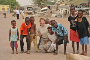 U.S. Army Spc. Danielle Gregory, 448th Civil Affairs Battalion, and local children pose for a photo during a medical civil assistance program visit, June 20, 2012, at a clinic in Damerjog, Djibouti. The 448th Civil Affairs Battalion, Fort Lewis, Wash., is deployed in support of Combined Joint Task Force-Horn of Africa.